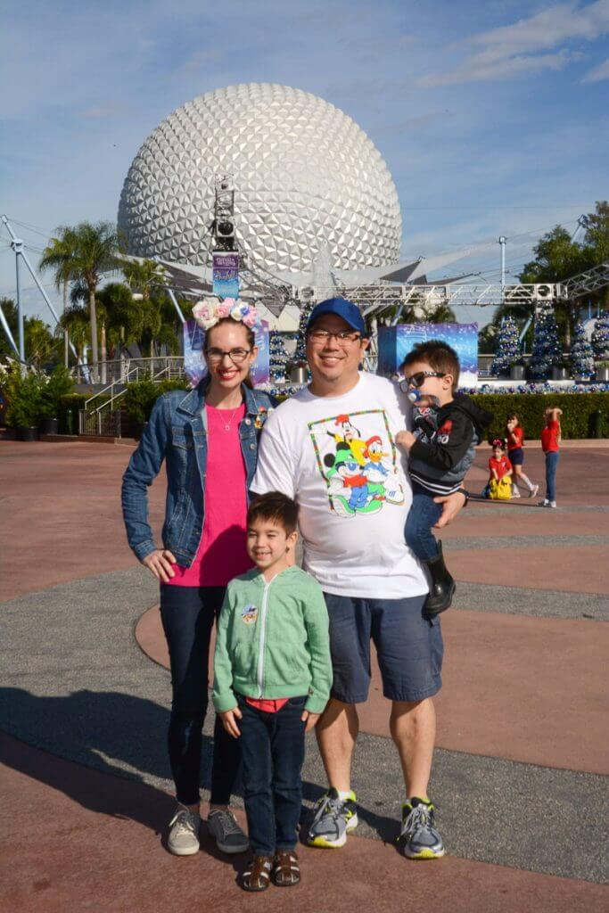 We had to get a family photo in front of the Epcot globe with a Disney PhotoPass photographer to add to our Memory Maker at Walt Disney World in Florida #epcot #waltdisneyworld #disneyworld #memorymaker #photopass