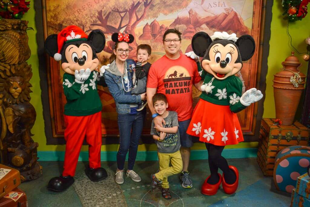 The Best Warm Places to Visit in December in the USA featured by top US travel blogger, Marcie in Mommyland: Mickey and Minnie Mouse dress up in holiday sweaters during the Holiday Season at Disney's Animal Kingdom Park. #mickey #minnie #wdw #waltdisneyworld