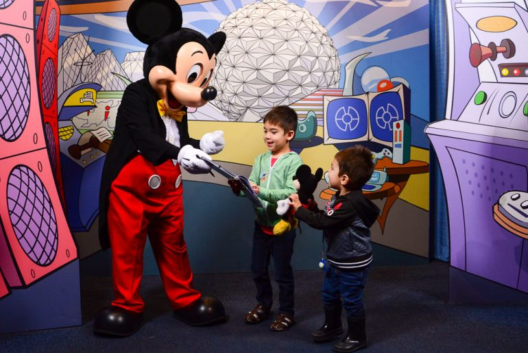 Mickey Mouse greets guests inside at the Epcot Character Spot at Walt Disney World in Orlando, Florida, which is definitely a must see attraction at Epcot with kids #epcot #mickeymouse #waltdisneyworld #disneyworld | Tips to spend one day at Epcot with Kids featured by top Disney blogger, Marcie in Mommyland