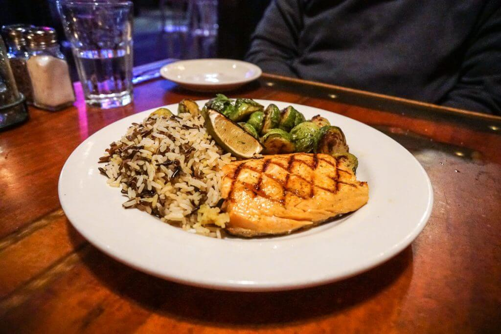 Classically grilled steelhead with rice pilaf and brussels sprouts at Fishermans Restaurant and Bar in Seattle WA