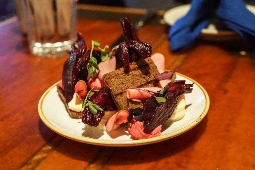 The goat cheese beet tartine at Fisherman's Restaurant & Bar in Seattle is a standout appetizer, perfect for a romantic Seattle date.