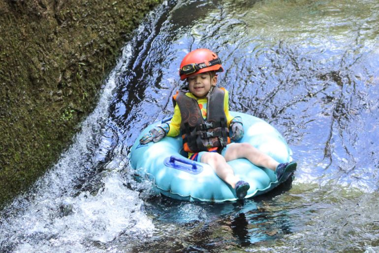 Kauai Backcountry Adventures feature's the only mountain tubing adventure on Kauai and it's a fun, kid-friendly Kauai adventure! #kauai #tubing #hawaii | Kauai Mountain Tubing in Sugar Cane Canals featured by top US travel blogger, Marcie in Mommyland