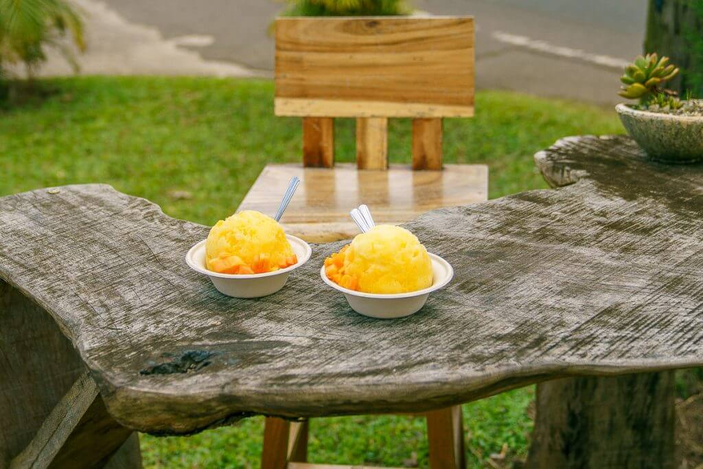 Wishing Well Shave Ice, in Hanalei, is one of the best shave ice spots on Kauai featuring organic syrups and fresh fruit. It's the final stop on the Tasting Kauai food tour of the North Shore.