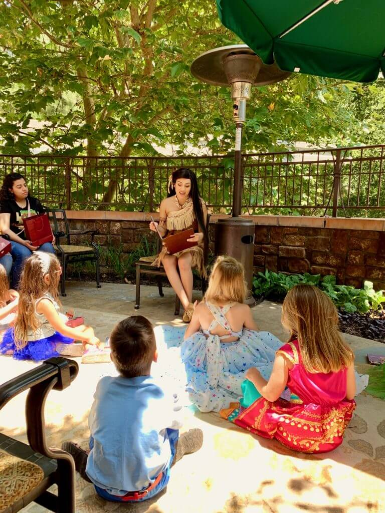 After breakfast, Pocahontas read a story to the kids at the new Disneyland princess breakfast character meal.