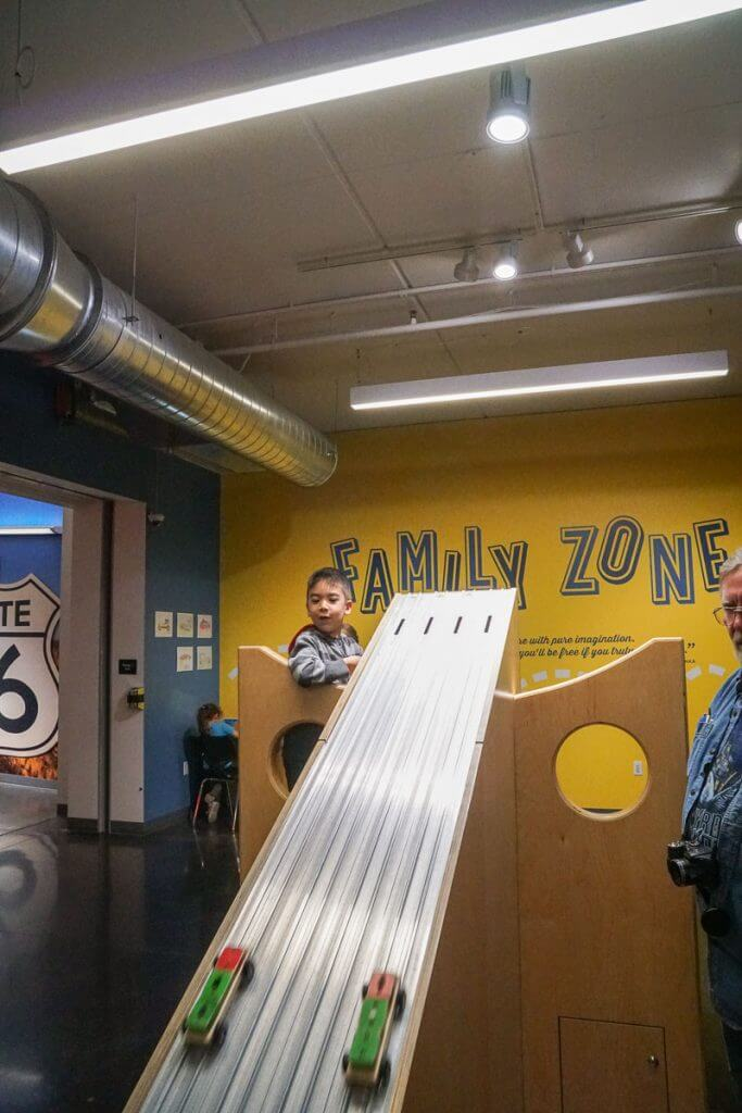 Kids will love hanging out in the Family Zone at America's Car Museum in Tacoma, WA where they can race pinewood cars and explore hands on exhibits for kids.