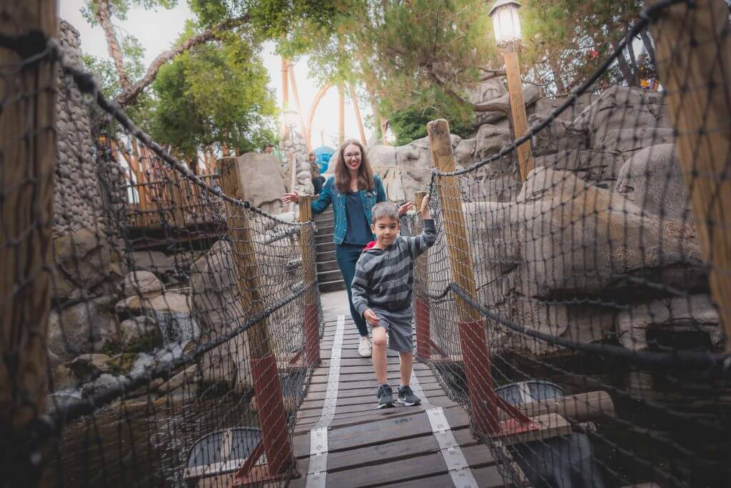 One of the best places to play at Knott's Berry Farm for kids is the bridges in Camp Snoopy