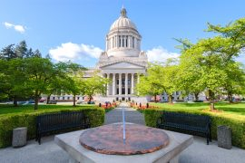 Visiting Olympia WA is an easy Seattle staycation for families | Recommendation for Visiting Olympia WA with kids featured by top US Seattle travel blogger, Marcie in Mommyland: image of the Olympia, WA capitol building.
