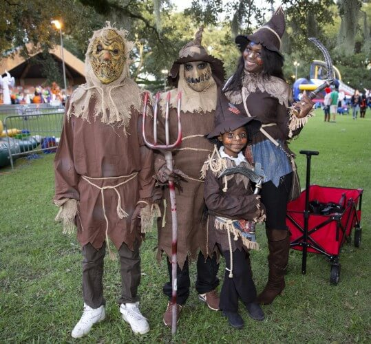 Photo of a family dressed up as scarecrows at the Boo at the Zoo event in New Orleans, Louisiana