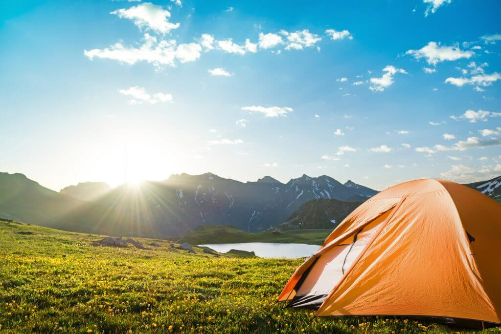 Camping is a great way to save money while traveling and is one of the best cheap travel tips