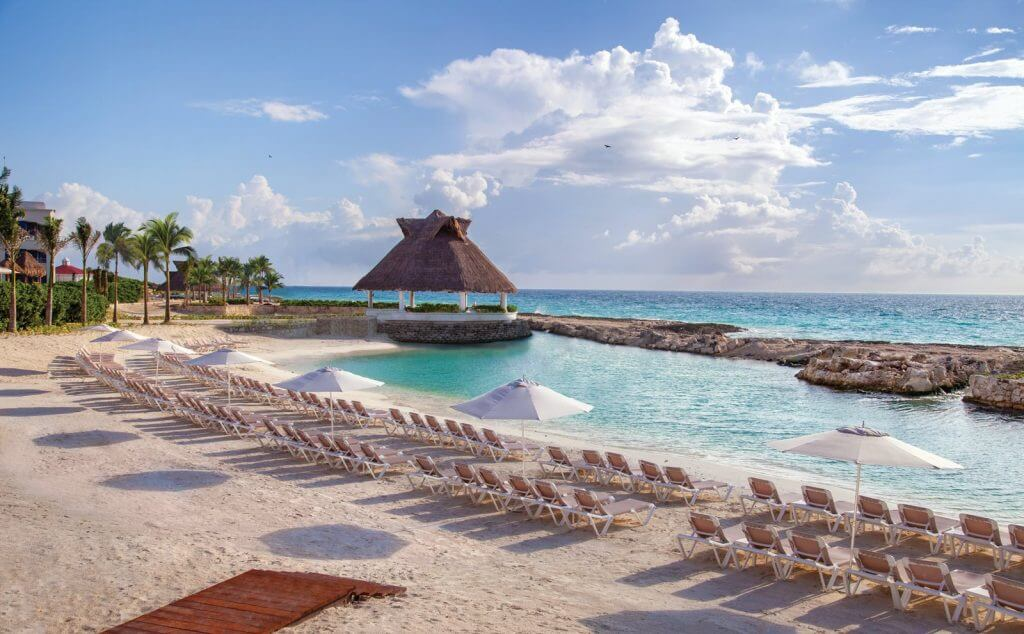 You'll want to enjoy the private beach at the Hard Rock Hotel Riviera Maya, an all-inclusive resort in Mexico