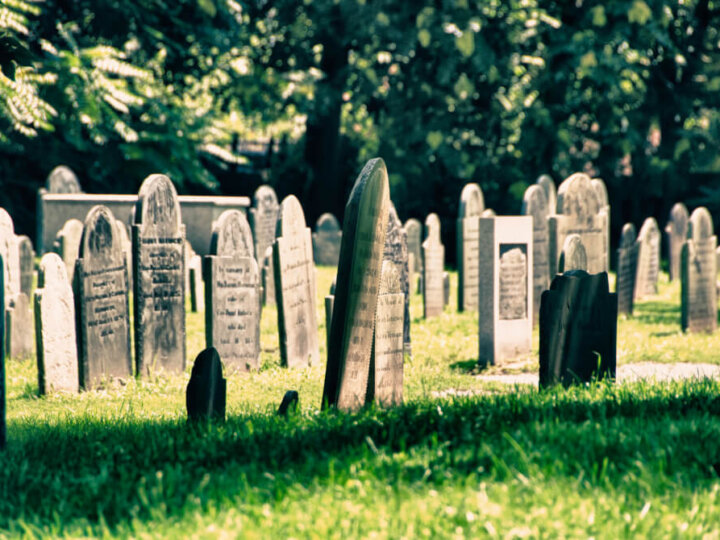 Salem, Massachusetts is one of the spookiest places to visit for Halloween. This is one of the best Halloween towns on the East Coast. Image of an old graveyard in Salem, Massachusetts.