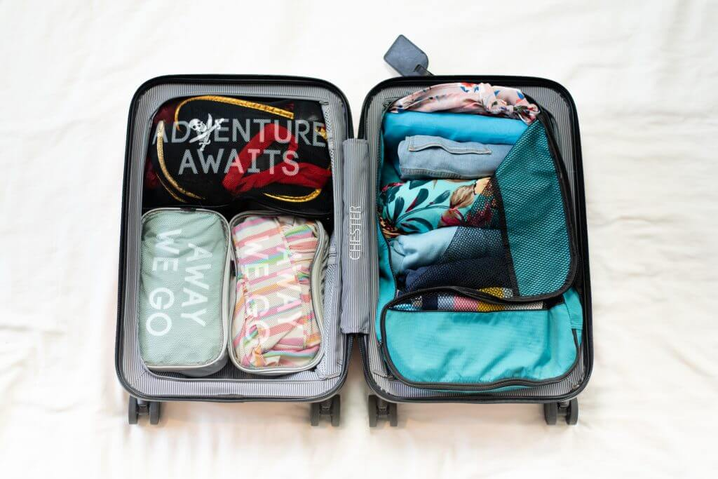 Chester Luggage set reviewed by top US family travel blogger, Marcie in Mommyland: Packing cubes are a great way to stay organized when traveling with kids.