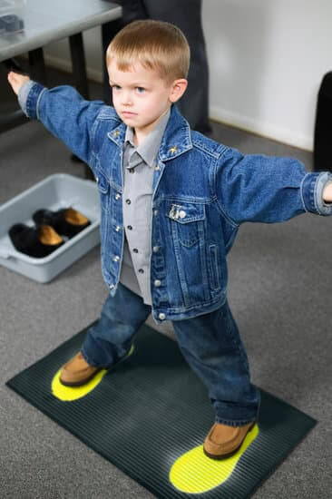 8 Tips for Getting Through Airport Security with Children featured by top US travel blogger, Marcie in Mommyland: Boy at Airport Security checkpoint