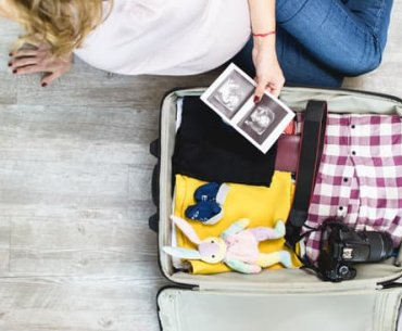 Hacks and Tips for Traveling While Pregnant featured by top US travel blogger, Marcie in Mommyland