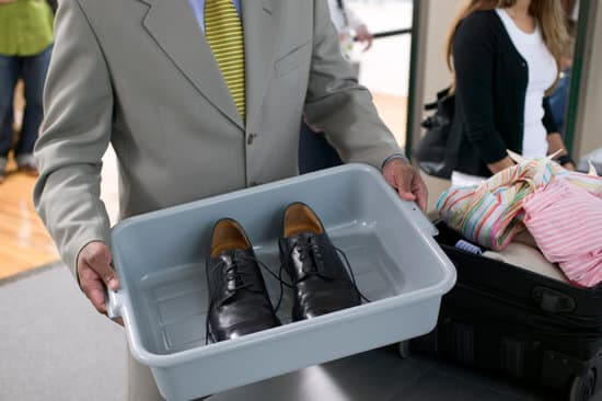 8 Tips for Getting Through Airport Security with Children featured by top US travel blogger, Marcie in Mommyland: Shoes in tray for airport security