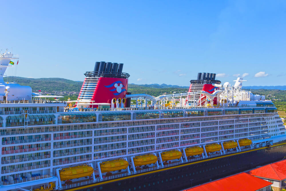 Best Cruises for Toddlers this Year featured by top US family travel blogger, Marcie in Mommyland: Cruise ship Disney Fantasy by Disney Cruise Line docked in Falmouth, Jamaica.