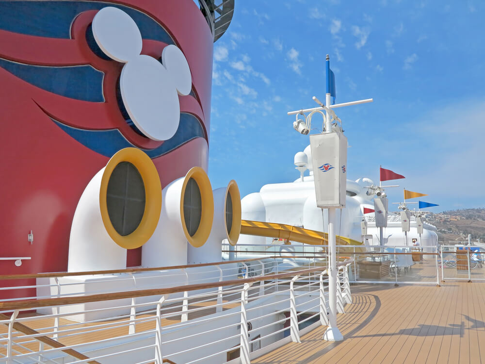Best Cruises for Toddlers this Year featured by top US family travel blogger, Marcie in Mommyland: The deck of the Disney Wonder whilst docked in Ensenada, Mexico, including the Disney Cruise Mickey logo.
