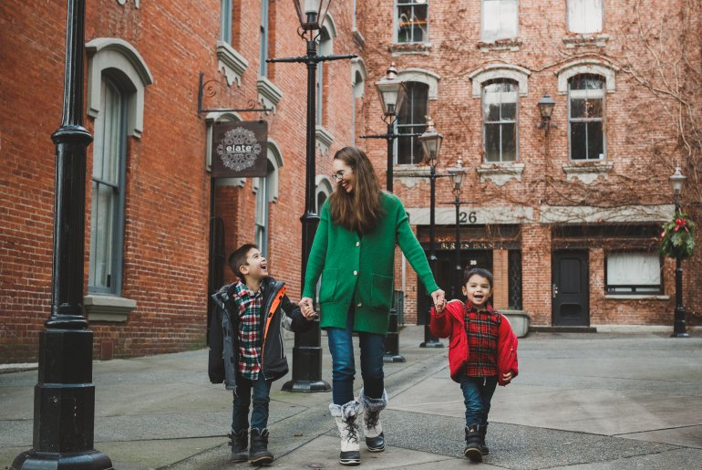 Christmas in Victoria BC: the Best Kid Friendly Festivities featured by top US family travel blogger, Marcie in Mommyland: A mom and two boys walking around Victoria, BC in December