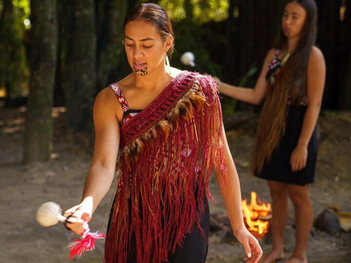 Tamaki Maori Village in Rotorua in New Zealand, a review featured by top US travel blogger, Marcie in Mommyland: Maori women dressed in traditional Maori attire using a poi ball
