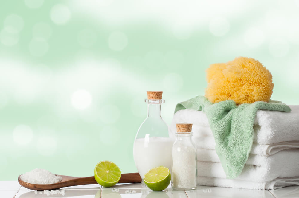 5 Easy At Home Date Night Ideas for You and Your Partner featured by top US life and style blogger, Marcie in Mommyland: Spa treatment with lime and salts with towels and sponge