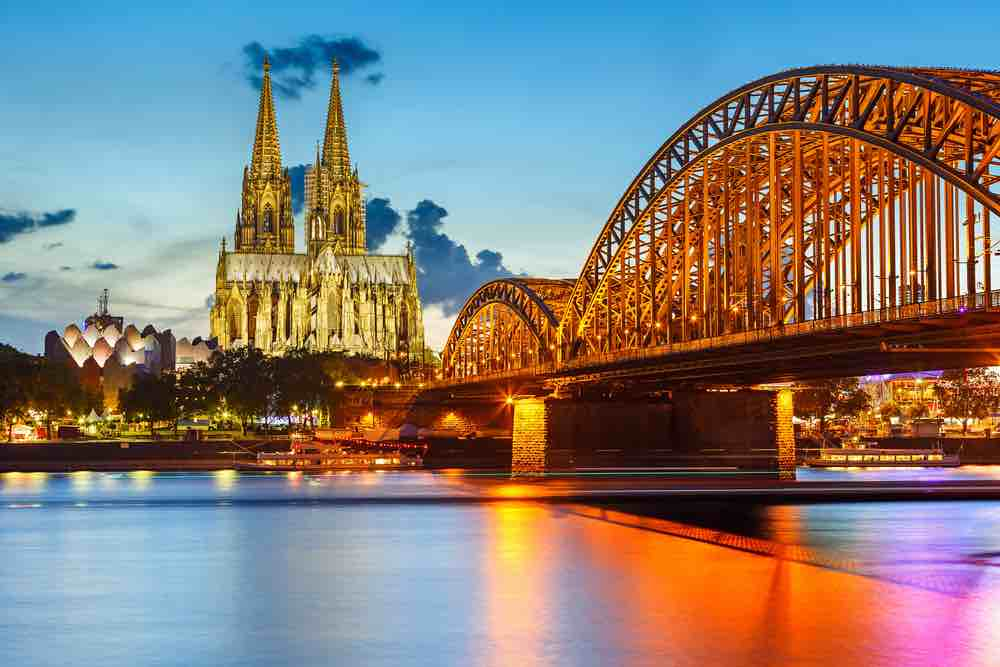 Germany on a Budget: 4 Top Travel Tips for Planning a Trip to Germany on a Shoestring featured by top family travel blogger, Marcie in Mommyland: View on Cologne Cathedral and Hohenzollern Bridge, Germany