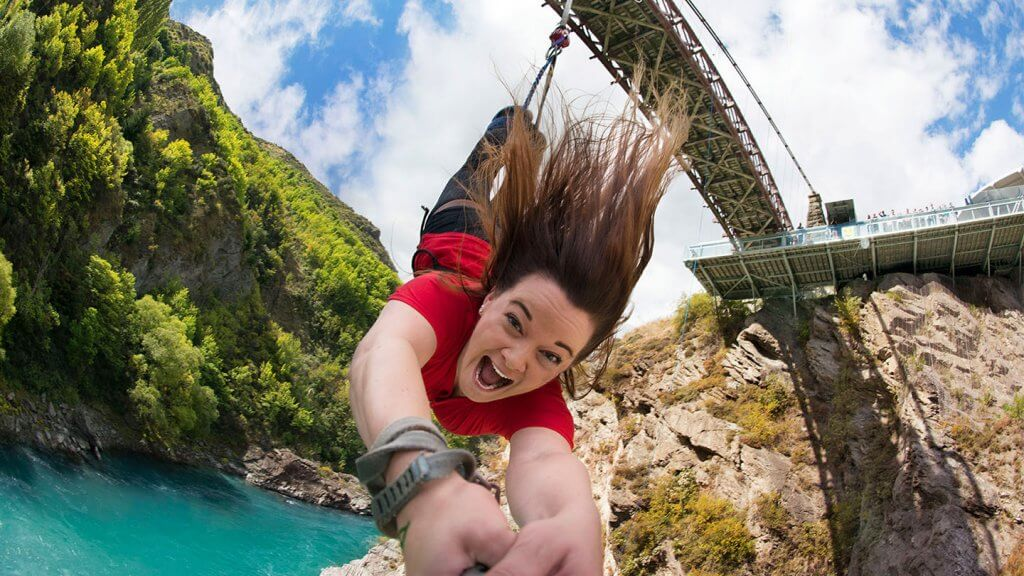 Top 12 Things to do in Queenstown with Kids featured by top family travel blogger, Marcie in Mommyland: Kawarau Bridge Bungy Jump in Queenstown New Zealand