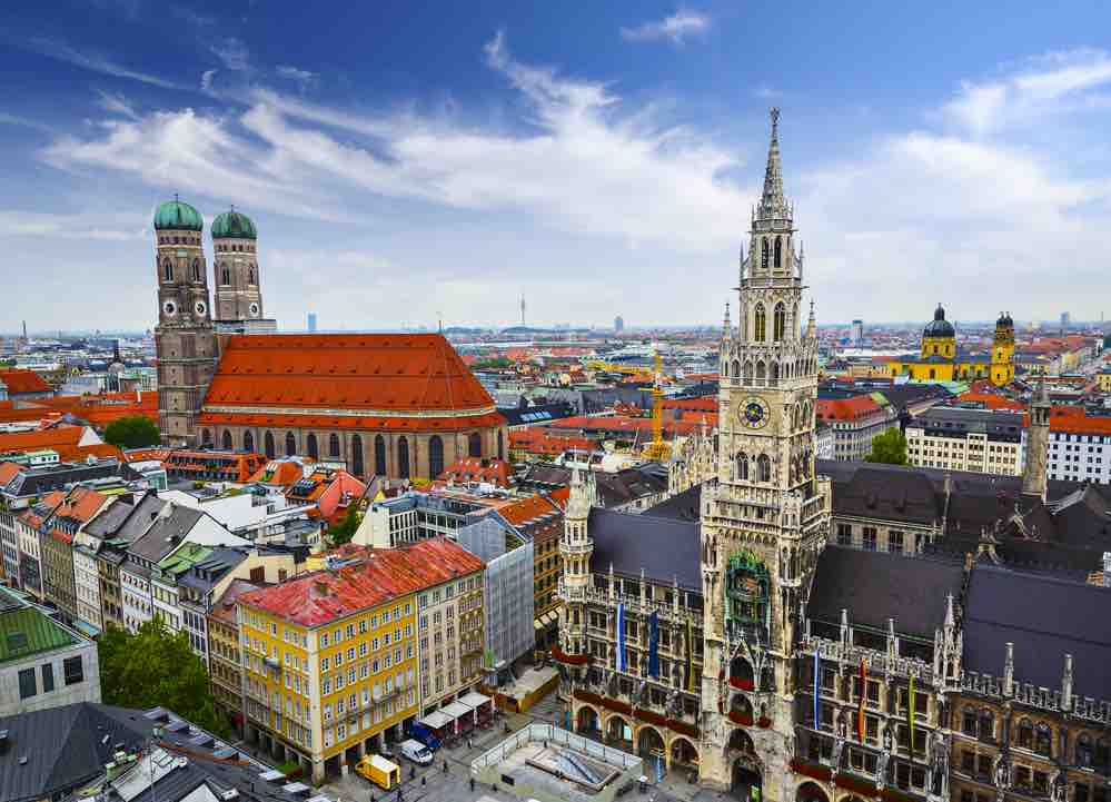 Germany on a Budget: 4 Top Travel Tips for Planning a Trip to Germany on a Shoestring featured by top family travel blogger, Marcie in Mommyland: Munich, Germany skyline at City Hall.