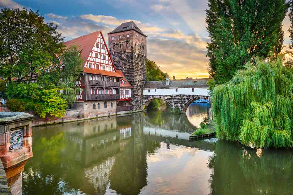 Germany on a Budget: 4 Top Travel Tips for Planning a Trip to Germany on a Shoestring featured by top family travel blogger, Marcie in Mommyland: Nuremberg, Germany at Hangman's Bridge over the Pegnitz River.