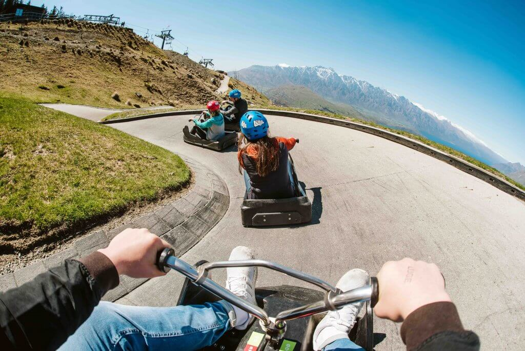 Top 12 Things to do in Queenstown with Kids featured by top family travel blogger, Marcie in Mommyland: Skyline Luge is a kid-friendly Queenstown activity