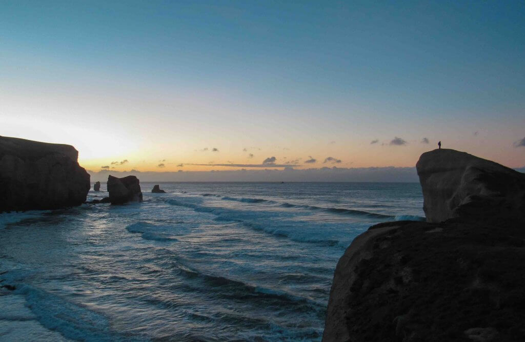 The Best Things to do in Dunedin New Zealand featured by top family travel blogger, Marcie in Mommyland: Tunnel Beach in Dunedin New Zealand