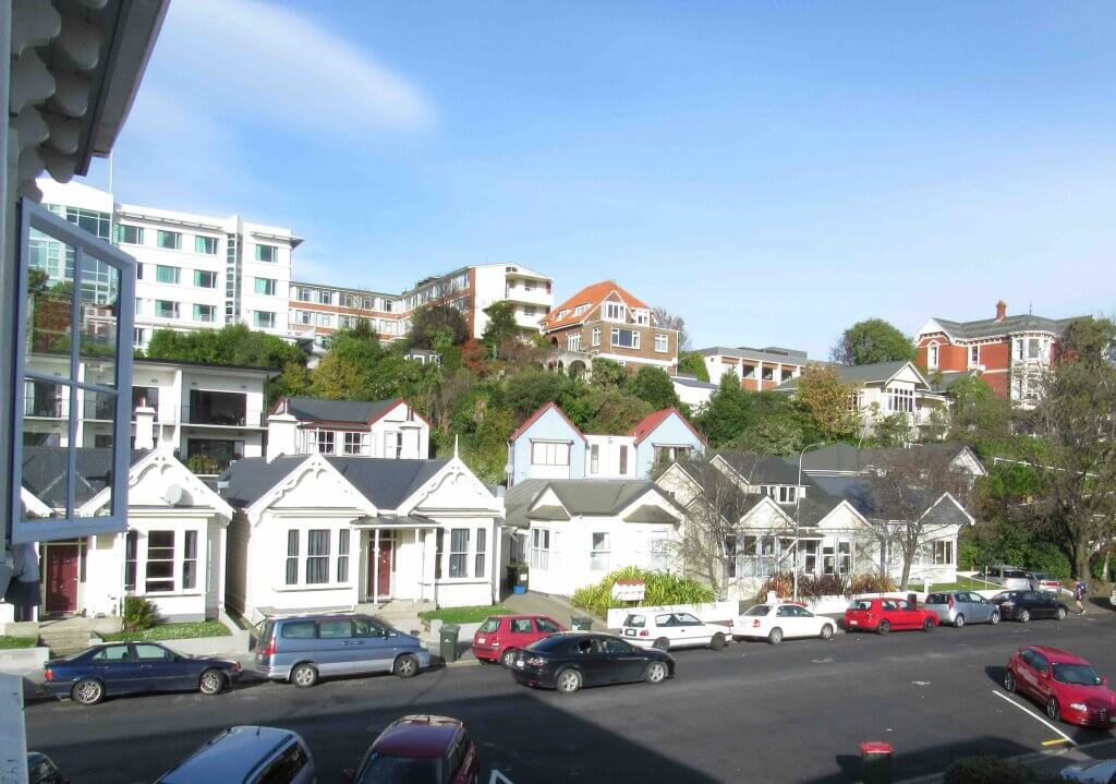 The Best Things to do in Dunedin New Zealand featured by top family travel blogger, Marcie in Mommyland: Residential street in Dunedin New Zealand