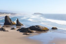 Top 12 Best Romantic Weekend Getaways from Seattle featured by top Seattle blogger, Marcie in Mommyland: beautiful rock formations at the beach in bandon, oregon
