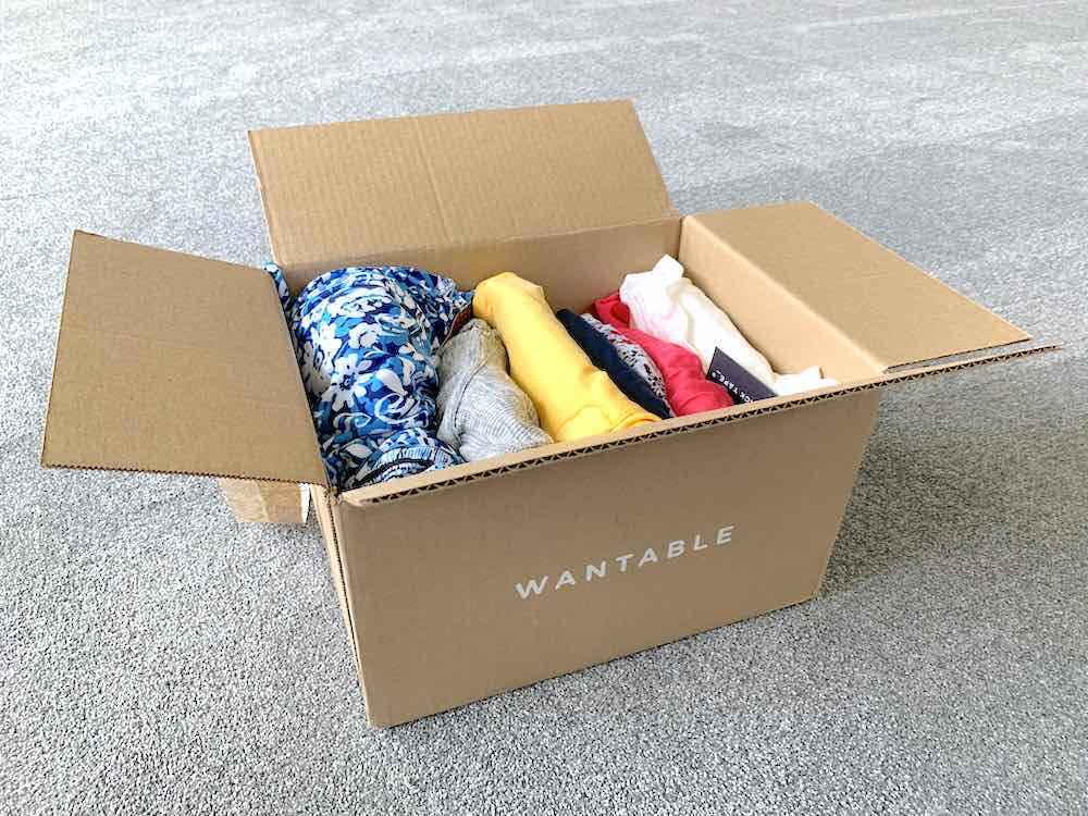 One of the best ways to celebrate Mother's Day with friends is by treating them to a Wantable subscription. Image of a Wantable subscription box with clothing inside.