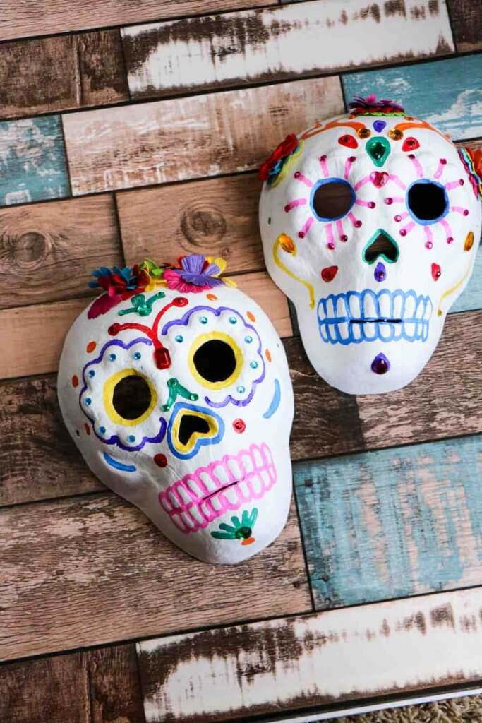 Day of the Dead Crafts and Activities for Kids featured by top Seattle lifestyle blogger, Marcie in Mommyland: Easy sugar skull craft for kids to celebrate Dia de Muertos. Image of a Day of the Dead craft for kids