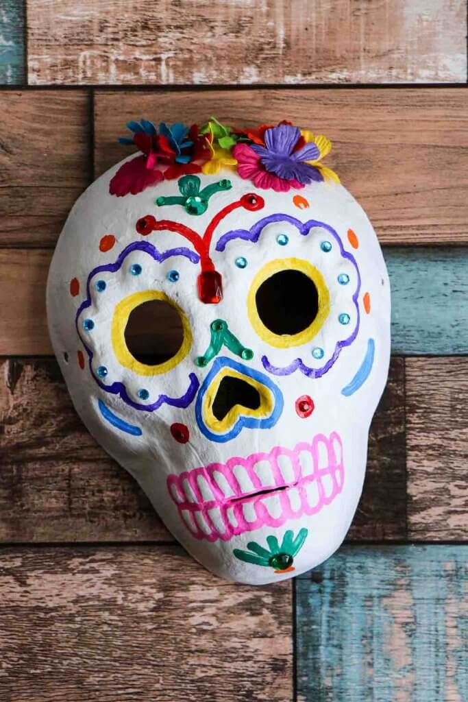 Dia de los Muertos Project for Kids: Sugar Skull Craft featured by top Seattle lifestyle blogger, Marcie in Mommyland: Easy Day of the Dead project for kids. Image of a paper sugar skull craft