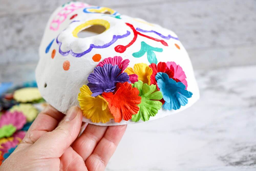 Dia de los Muertos Project for Kids: Sugar Skull Craft featured by top Seattle lifestyle blogger, Marcie in Mommyland: Add flowers to your sugar skull Day of the Dead craft