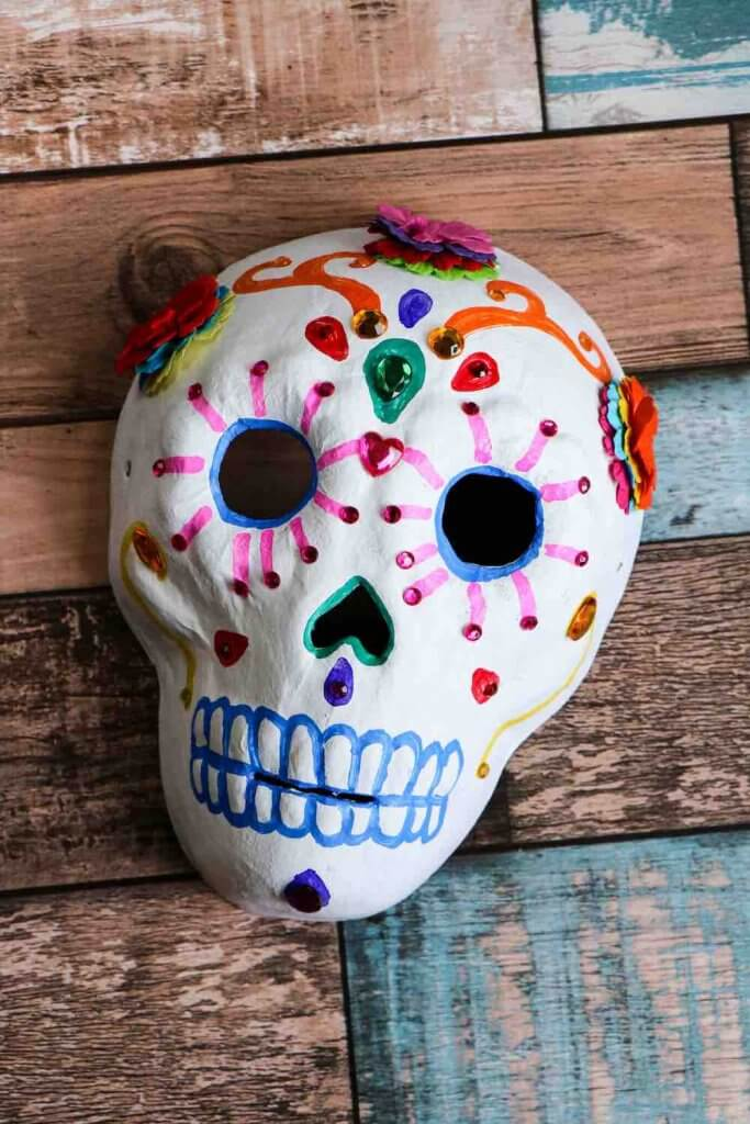 Dia de los Muertos Project for Kids: Sugar Skull Craft featured by top Seattle lifestyle blogger, Marcie in Mommyland: Completed Dia de los Muertos sugar skull craft