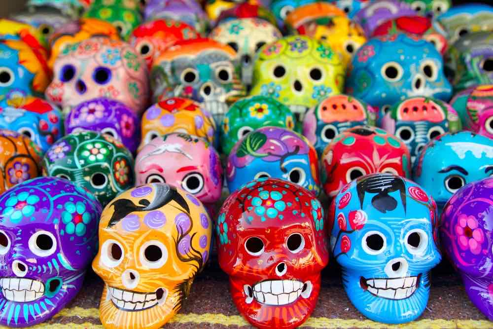 Fun Things to Do at Home on Halloween with Kids featured by top Seattle lifestyle blogger, Marcie in Mommyland. Aztec skulls Mexican Day of the Dead colorful handcrafts