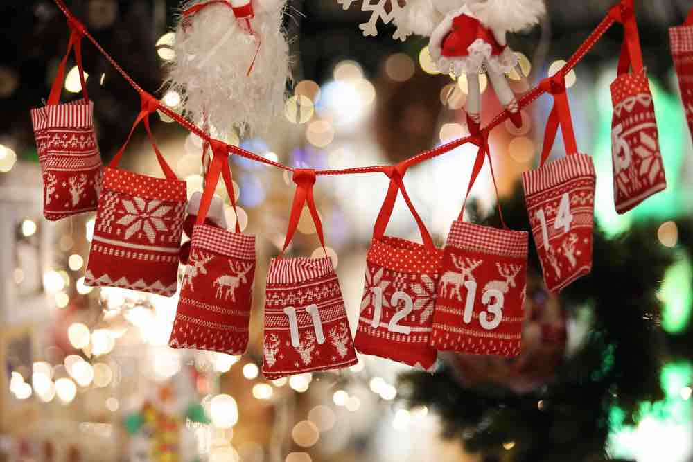 15 Free Festive Christmas Traditions That Don't Cost a Dime featured by top Seattle lifestyle blogger, Marcie in Mommyland: Creat your own advent calendar for Christmas. Image of Christmas Advent Calendar on Bag Gifts