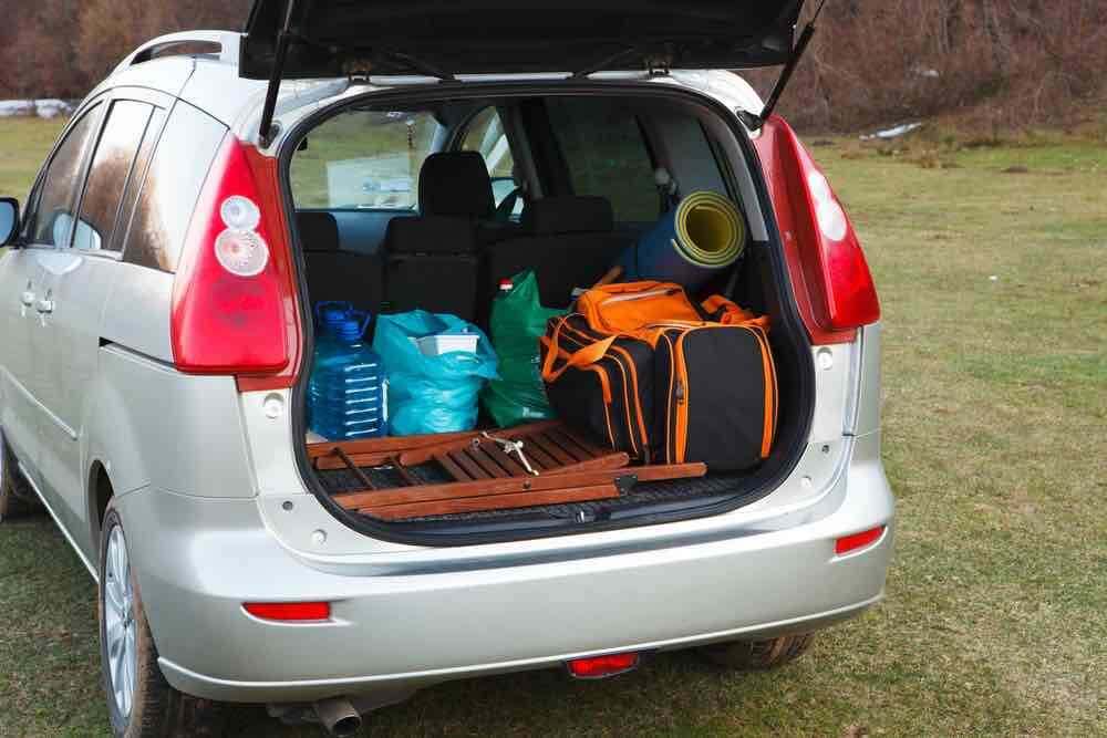 10 Best Secret Places to Hide Christmas Presents featured by top US lifestyle blogger, Marcie in Mommyland: You can hide Christmas presents in your car. Image of hatchback car loaded with open trunk and luggage