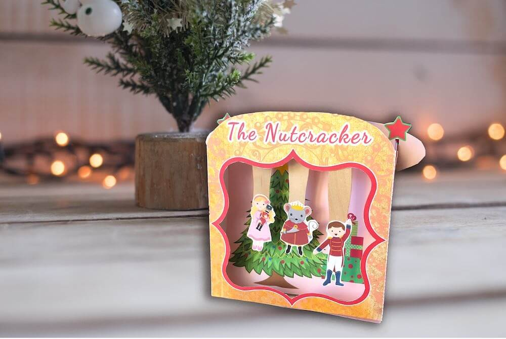 Best Christmas Paper Crafts featured by top Seattle lifestyle blogger, Marcie in Mommyland: Learn how to make a Nutcracker Ballet Stage Kit including free Nutcracker Printables! Image of a Nutcracker paper puppet theater