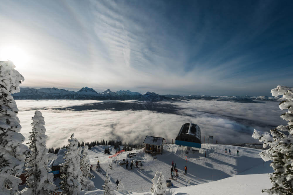Best Winter Weekend Getaways from Seattle featured by top Seattle travel blogger, Marcie in Mommyland: Image of an aerial shot of Revelstoke, British Columbia in Winter