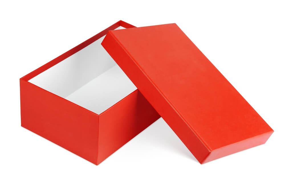 How to Store Christmas Ornaments So They Won't Break, tips featured by top Seattle lifestyle blogger, Marcie in Mommyland: Shoe boxes are perfect for storing Christmas ornaments. Image of Open red shoe box isolated on white with clipping path