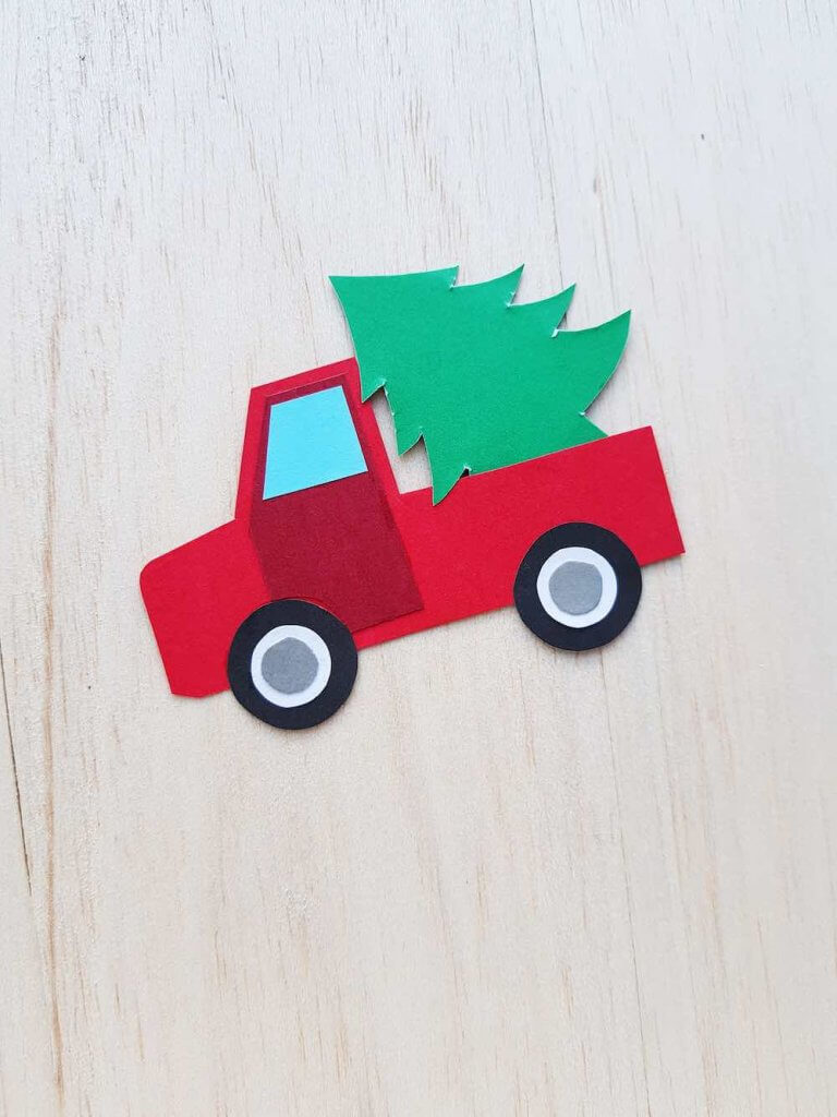 Red Truck with Christmas Tree Craft Tutorial, a Christmas Crafts featured by top Seattle lifestyle blogger, Marcie in Mommyland: Image of completed Christmas Truck Paper Craft