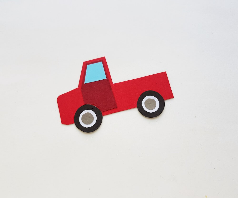 Red Truck with Christmas Tree Craft Tutorial, a Christmas Crafts featured by top Seattle lifestyle blogger, Marcie in Mommyland: Image of completed red Christmas truck