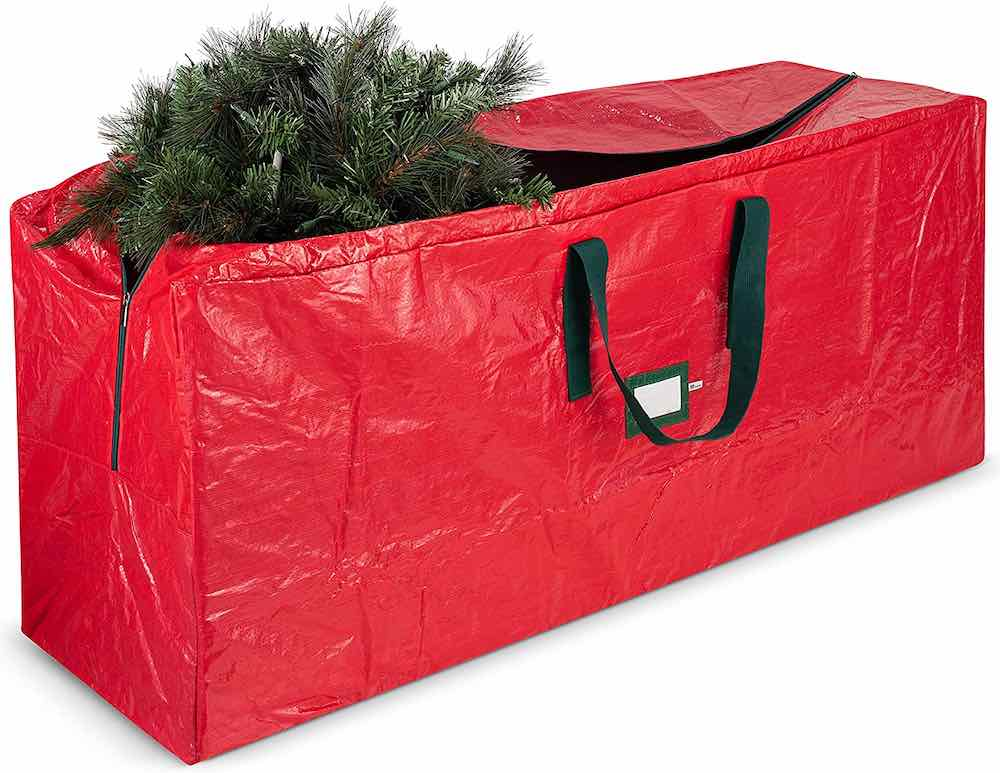 Christmas Decoration Storage Ideas and Tips featured by top Seattle lifestyle blogger, Marcie in Mommyland: One of the best ways to store artificial Christmas trees is in a bag like this red Christmas tree storage bag.