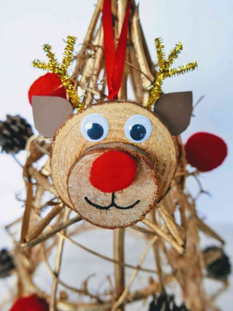Final image of the DIY reindeer ornament hung on a wooden stick tree.