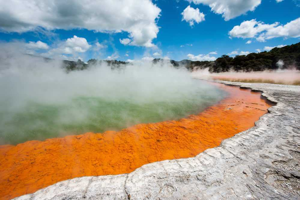 Visiting Frying Pan is a top thing to do in Rotorua, New Zealand. Image of Frying pan lake is the largest hot water spring in the world. Rotorua, Waimangu geothermal area, New Zealand