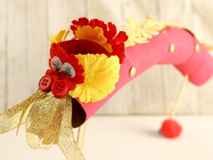 Find out how to make this Chinese New Year Dragon Craft by top Seattle lifestyle blog Marcie in Mommyland. Image of a cardboard tube dragon craft for Chinese New Year