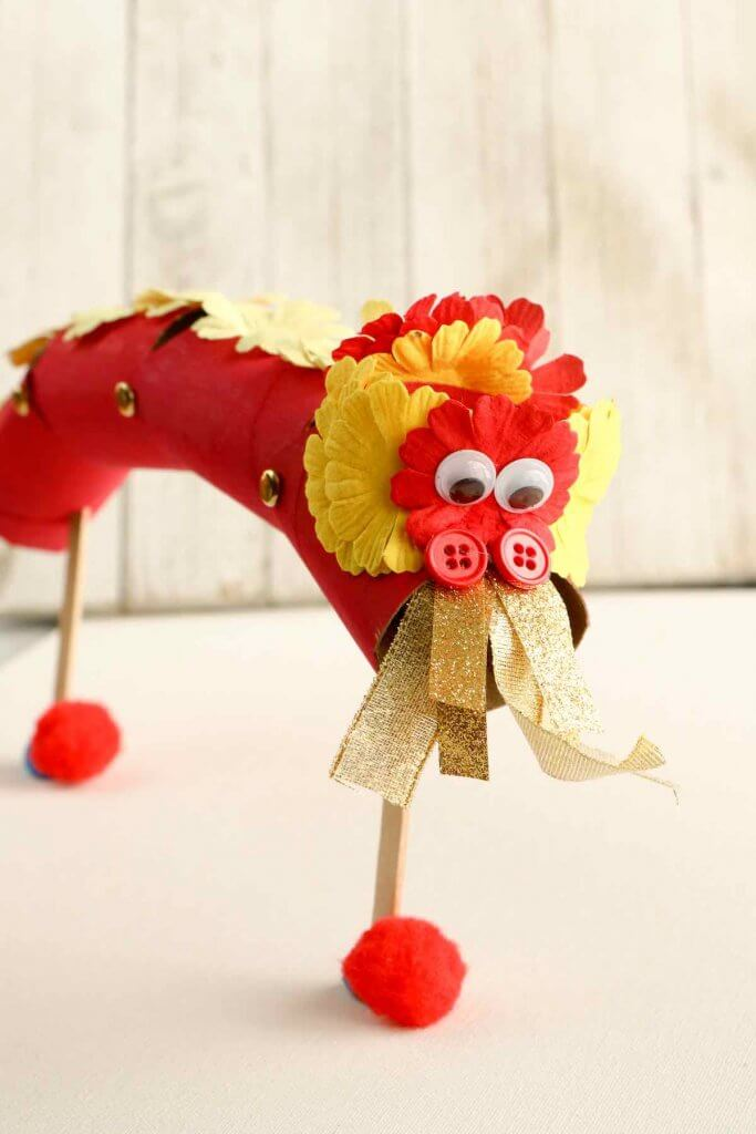Learn how to make this Chinese New Year kids craft. Image of a cardboard tube Chinese Dragon puppet.